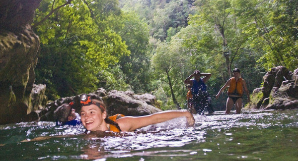 blue creek wet cave adventure swim
