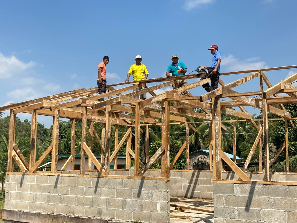Cotton Tree Lodge crew building medical clinic for San Felipe Village
