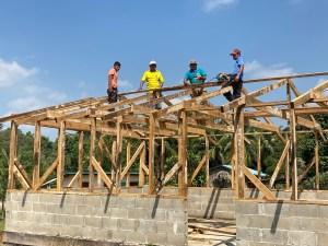 Cotton Tree Lodge crew building medical clinic for San Felipe Village